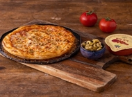 מלוואח פיצה - מומלץ!, ניתן לשלב כל תוספת מתוספות הפיצה (עד 2 תוספות).תוספת נוספת 3 ₪.