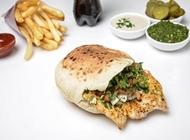 עסקית חזה עוף בפיתה פלאפל ג'ינה שוקן תל אביב