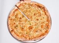 מבצע פיצה משפחתית + 2 תוספות למגש פיצה דונטלו תל אביב
