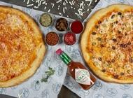 2 מגשים XL (ענקיים) + תוספת למגש אחד / שתיה 1.5 ליטר פיצה אנג'ל הרצליה